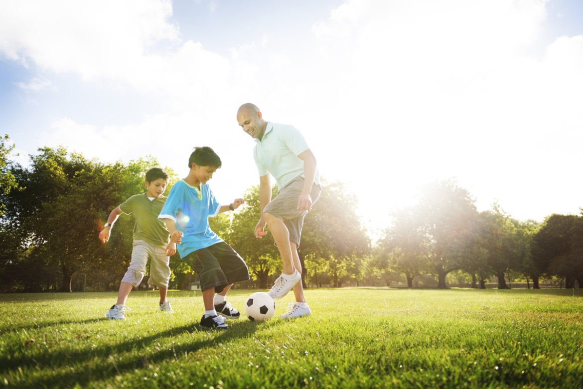 A family playing soccer.